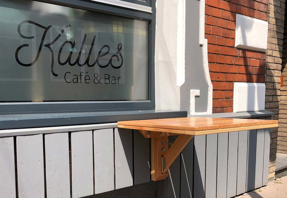 Afbeelding van een outdoor klaptafel voor een café en bar.