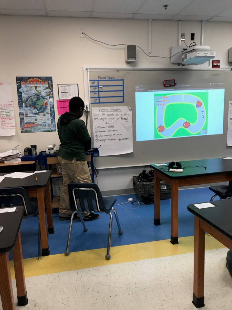 A Code4Life participant at KIPP Key Academy in DC demonstrations his animation project.