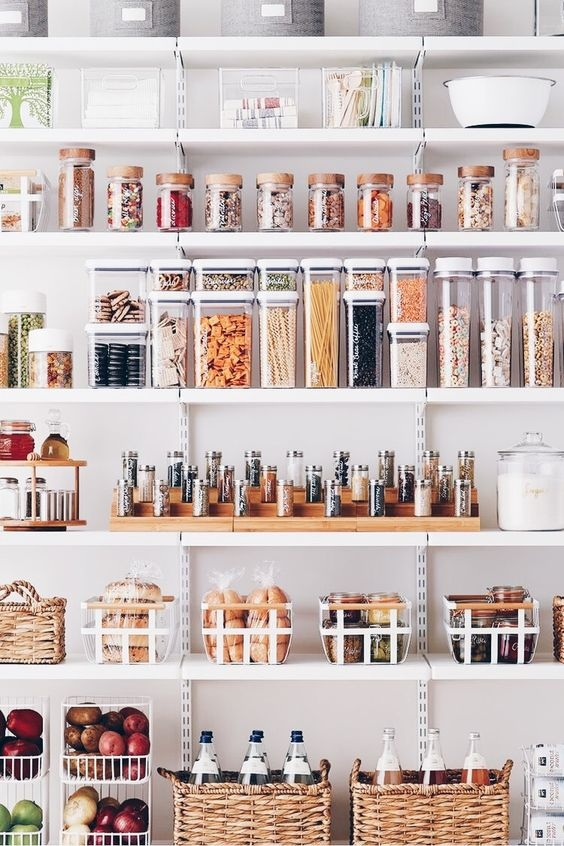 - While I love the idea of those stackable containers, I'm not sure they're exactly my style. I'm obsessed with the jars on top though. My favourite thing about this pantry are the different baskets to keep produce, bottles, bread, and smaller jars. All the elements really work well together and I love the mix of light wood, light wicker, and white metal.