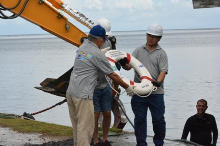 Takei-san presented the buoy to Ngirturong John Sugiyama