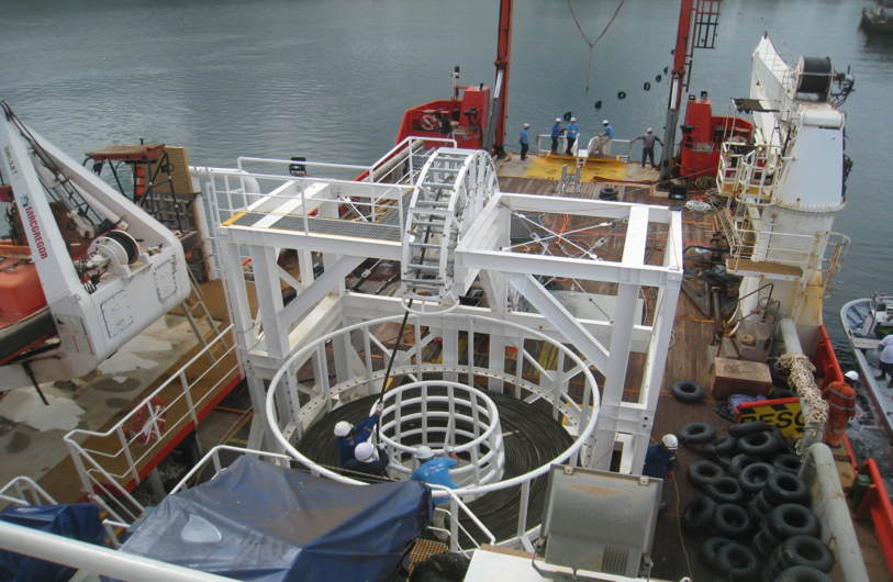Buoys being attached to the cable during pull-in