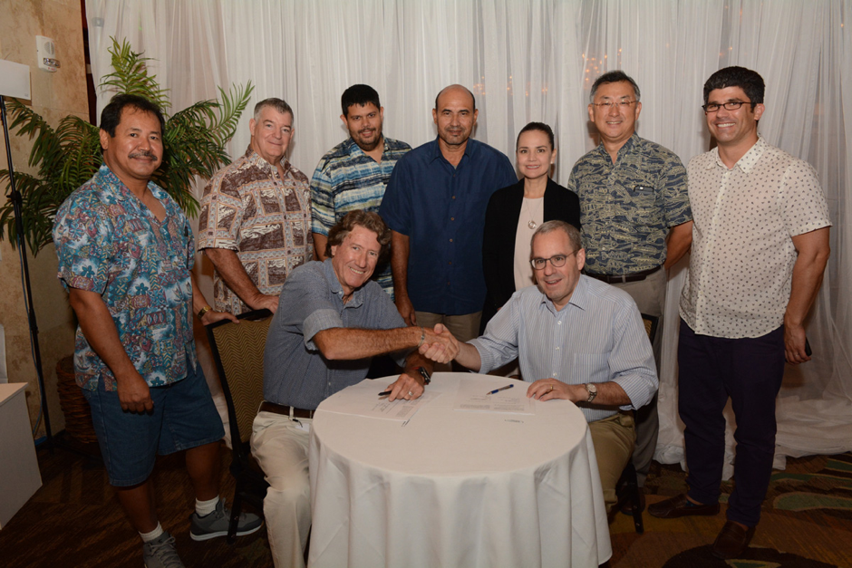 The Docomo Pacific and BSCC teams at the signing of the service agreement that underpins operation of BSCC's Customer Service Center (CSC) in Guam.