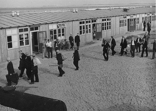 Workers arriving at the barracks in the new polder (in 'Sunday' clothes!)