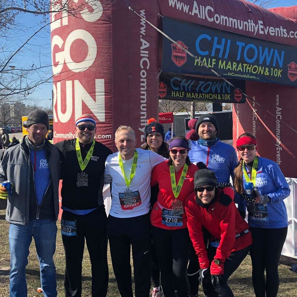 Brian and Jeff, posing with a bunch of actual runners after their last Half Marathon