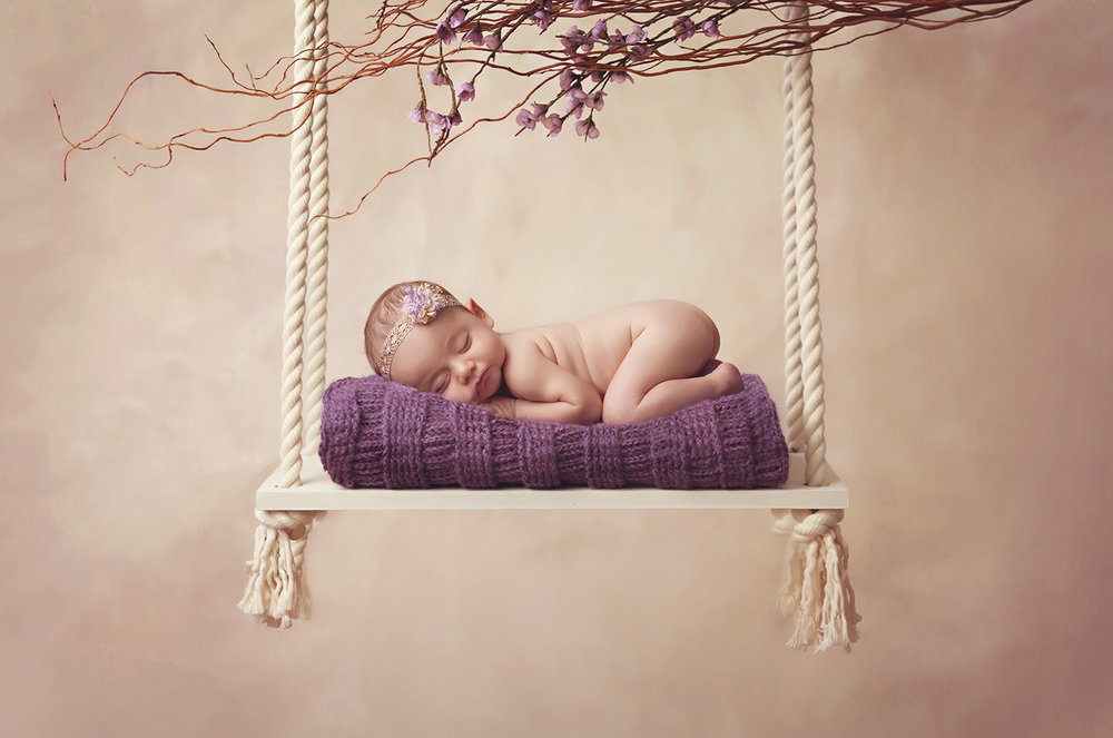 Sleeping baby girl on swing