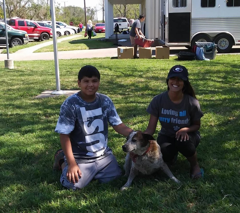 Kiren from no Kill COlorado with Maurice (middle) and a resident of Bloomington TX.  Maurice's family lost thier home.  It was completely destroyed.  They left Maurice with friends and he was the relief operations mascot in Bloomington TX.