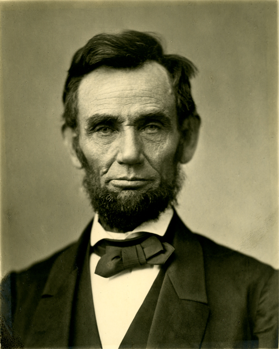 An iconic photograph of a bearded Abraham Lincoln showing his head and shoulders. Alexander Gardner [Public domain], via Wikimedia Commons