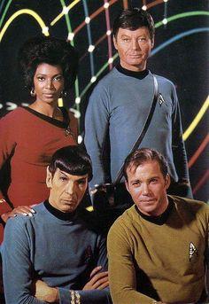 Publicity shot of Lt. Uhura, Dr. McCoy, Cdr. Spock, and Cpt. Kirk for Star Trek
