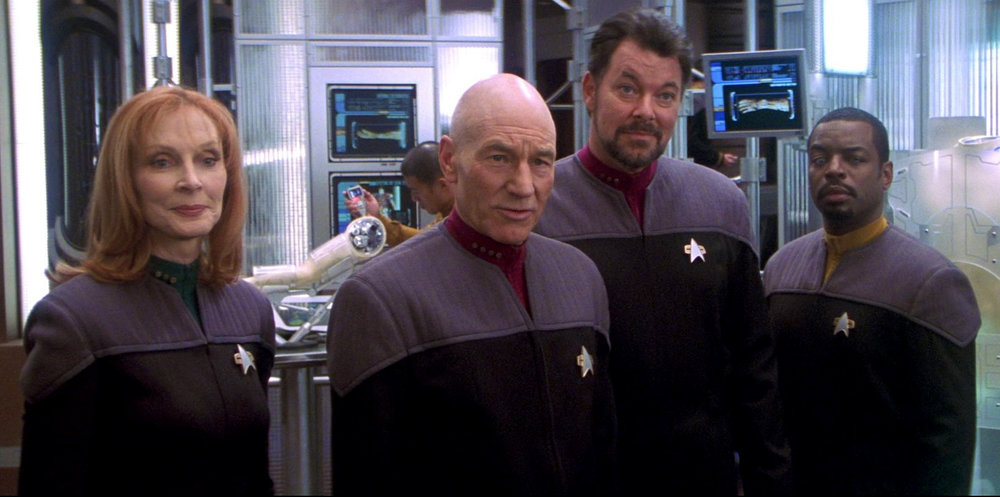 Dr. Crusher, Cpt. Picard, Cdr. Riker, and Lt. Cdr. La Forge during Star Trek Nemesis