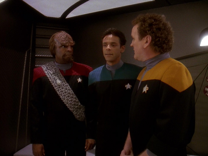 Lt. Cdr. Worf, Dr. Bashir, and SCPO O'Brien in the brig after Worf patronized a business where the workers were on strike during the episode Bar Association