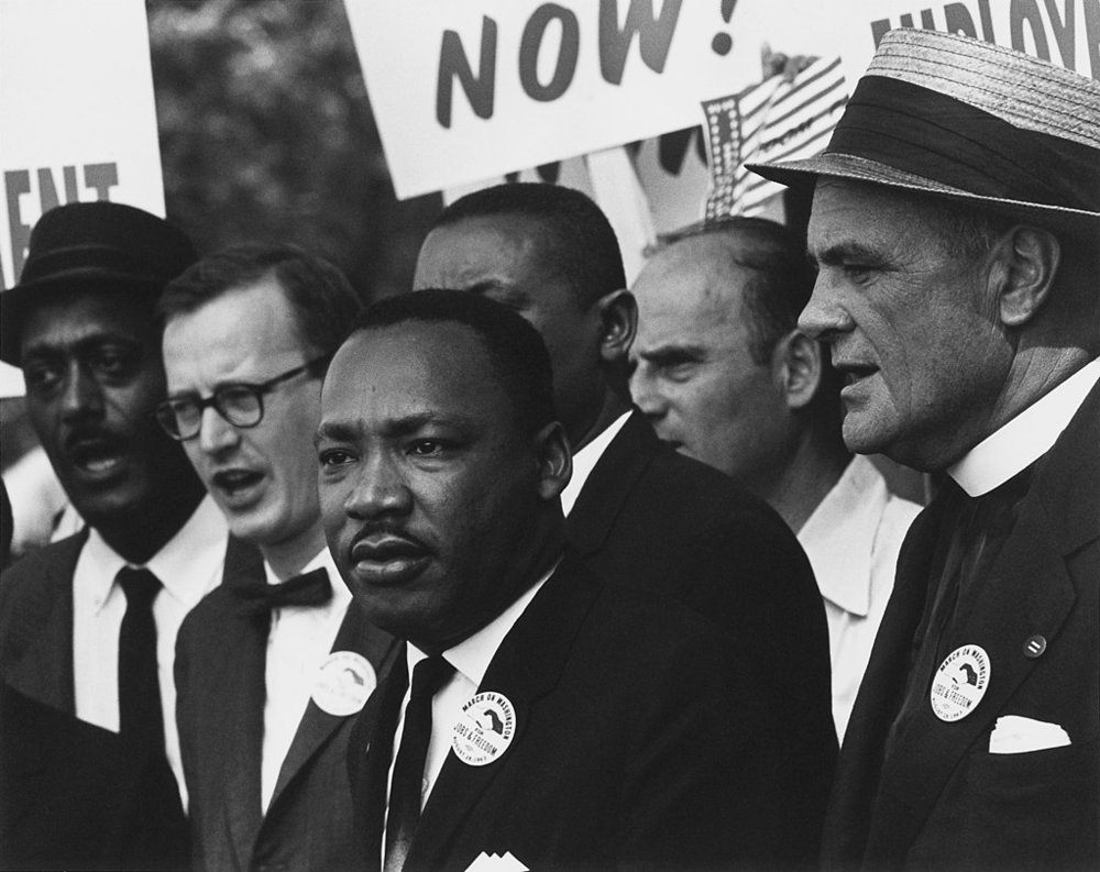Civil Rights March on Washington, D.C. (Dr. Martin Luther King, Jr. and Mathew Ahmann in a crowd.)  By Rowland Scherman; restored by Adam Cuerden (U.S. National Archives and Records Administration) [CC0 or Public domain], via Wikimedia Commons