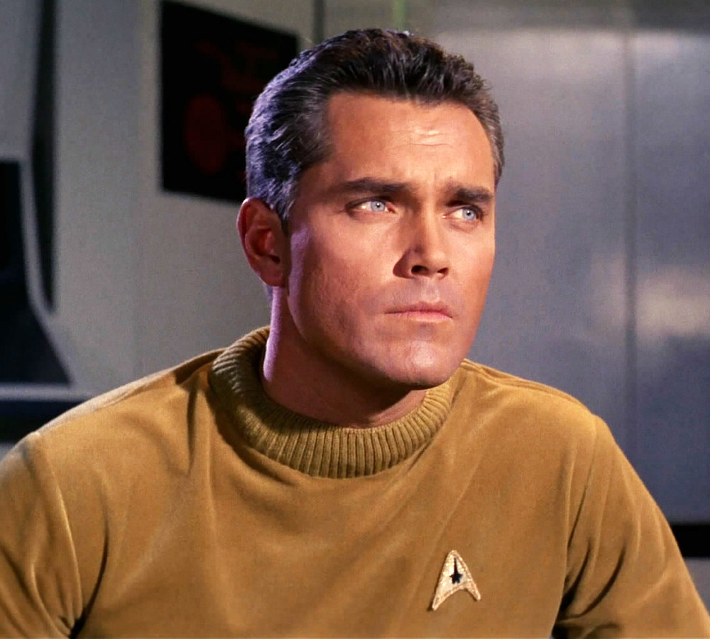 Command division uniform, male, 2254  Fair Use  - this image is copyrighted, but used here under  Fair Use  guidelines. Owner/Creator: Paramount Pictures and/or CBS Studios  Captain Christopher Pike  Retreived via http://memory-alpha.wikia.com