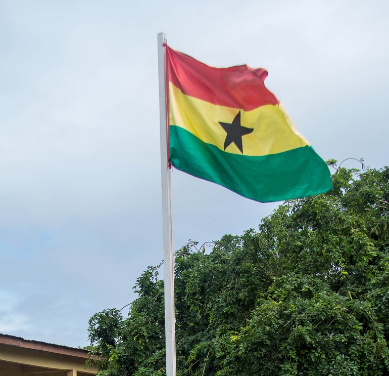 Flag of Ghana raised high and flowing. By OER Africa [CC BY 3.0 (http://creativecommons.org/licenses/by/3.0) or CC BY-SA 3.0 (https://creativecommons.org/licenses/by-sa/3.0)], via Wikimedia Commons