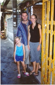 Ashley, Anji and Amy Barker outside their home in a Bangkok slum