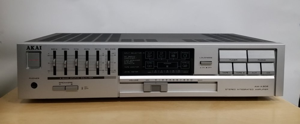 Akai AM-A302   Stereo integrated amplifier:features include inputs for phono,tuner,cd,aux and 2 tapes. Has 2 sets of speaker outlets.  Power output: 60 watts per channel into 8Ω (stereo)  Frequency response: 20Hz to 20kHz  Total harmonic distortion: 0.09%  Damping factor: 45  Input sensitivity: 2.5mV (MM), 150mV (line)  Signal to noise ratio: 72dB (MM), 95dB (line)  Channel separation: 60dB (line)  Output: 150mV (line)  Speaker load impedance: 8Ω to 16Ω  Dimensions: 440 x 100 x 250mm  Weight: 6.8kg   Great Amp, only $235