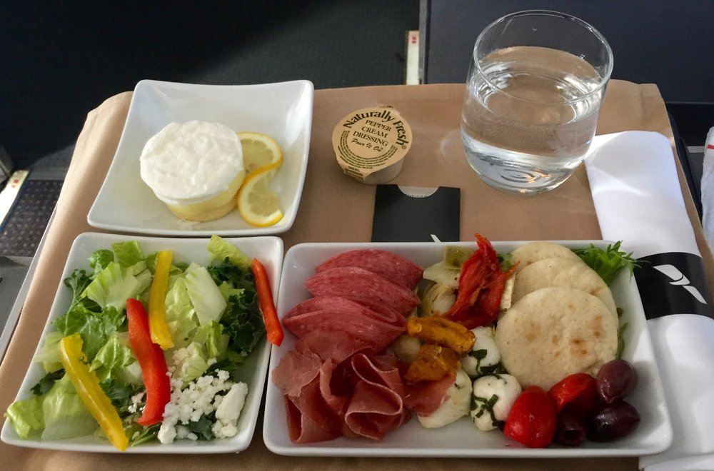 Or dining in style with a delicious meat and cheese plate, alongside a tasty kale and romaine salad!