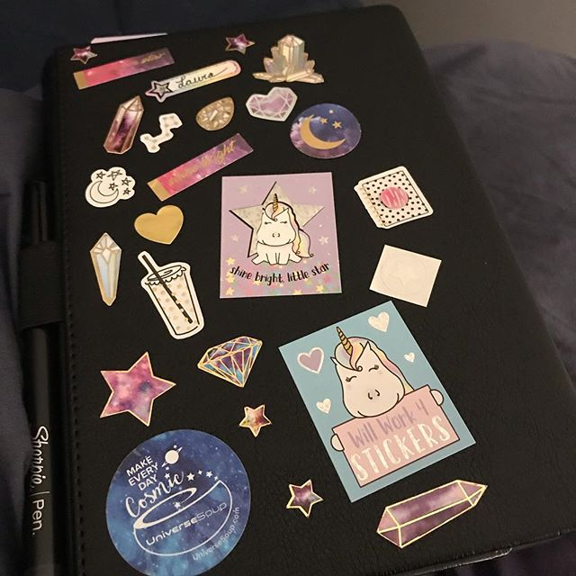 Making every day cosmic by covering my journal in cute space, unicorn, rock, and crystal stickers. I even made the tiny holo star sticker myself. So fun! ✨ #makeeverydaycosmic #holostickers #stickers #journal #bujo #universesoup