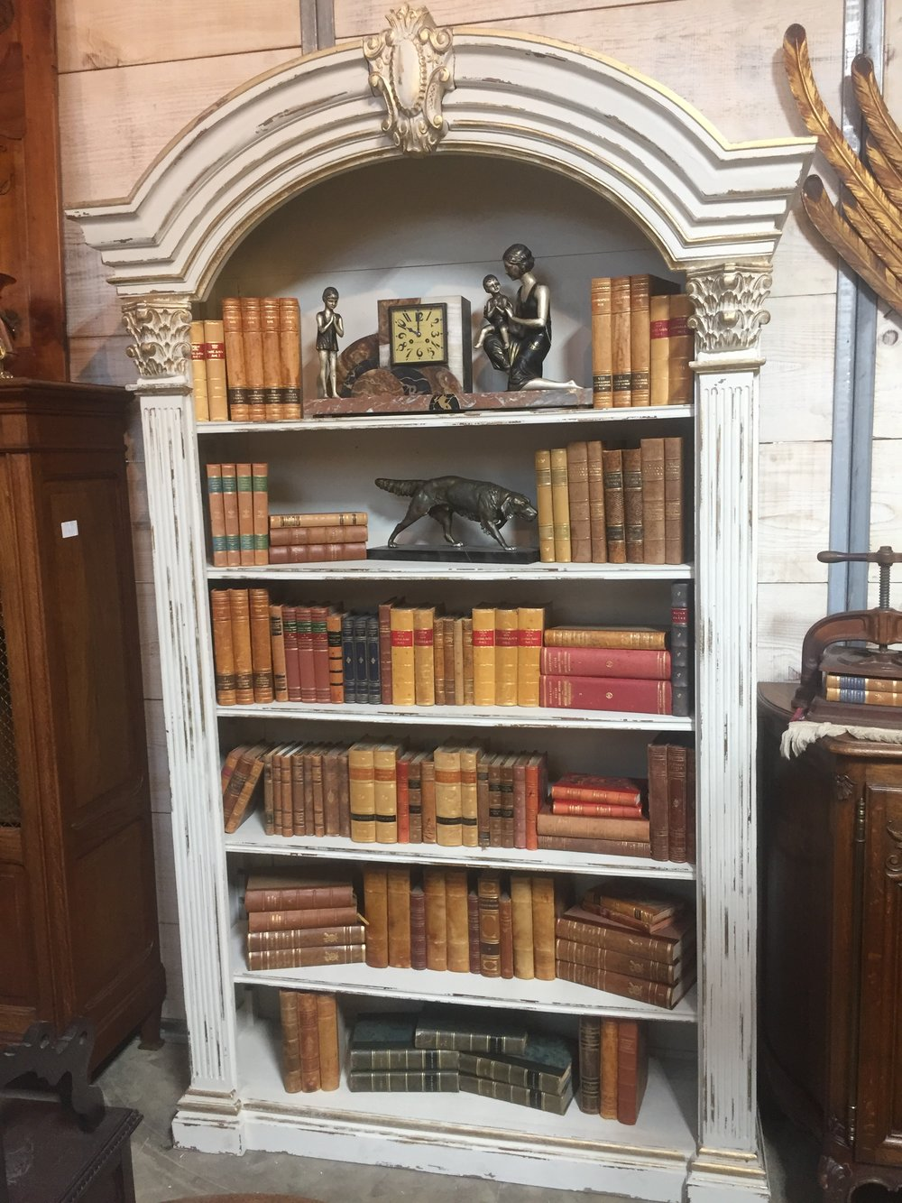 Vintage European Leather books in a White Washed open bookcase.JPG