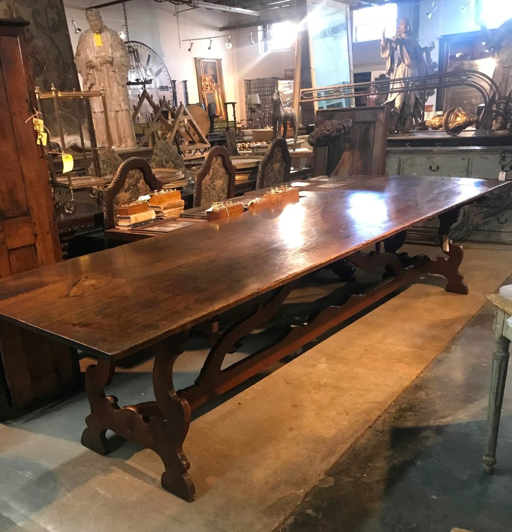 An exceptional and grand scale 18th century northern Italian trestle table/dining table. Superbly constructed from stunning walnut and classical Lyre legs and wonderfully sculpted stretchers. Sensational patina and graining. A truly exquisite table.