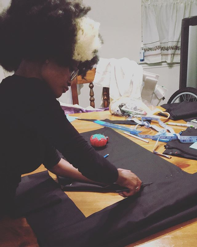 "Our busy 🐝 @rey_faith is working hard prepping for the QueensANU lookbook AND for the Texas Woman's University's Natural hair fashion show called ""Ebony,"" by TWU's Natural Society! Our designs are going to walk the runway! Are you as excited as we are?  Only 2 and a half more garments to go! . . . #QueensANU #lookbook #texaswomansuniversity #fashionshow #texas #designer #design #fashion #fashionista #afro #naturalhair #naturalista #fashiondiaries #fashionblogger #fashionblog #fashionstyle #student #college #fashionstudent #style #styles #stylish #browngirl #browngirlbloggers #blackbloggers #blackswhoblog #naturalhaircommunity #naturalhairdaily #photooftheday"