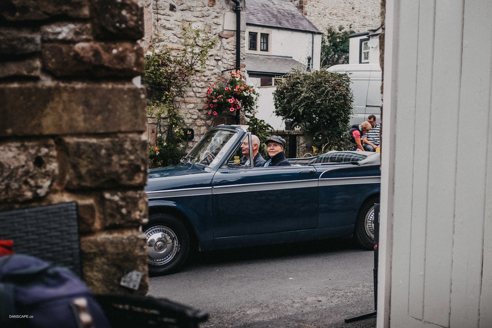An old car makes it's way through Bonsall