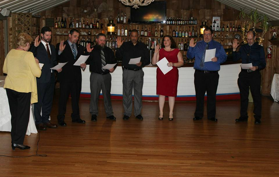 Left to right: Tina Wetter, Mike Kane, Demetri, Mike Westman, Steve Emanuel, Angie Roche, Sean & Mark Tolbert.