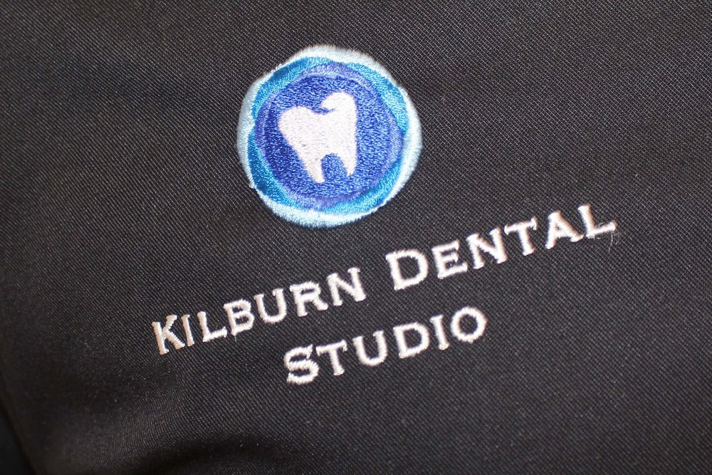Kilburn Dental uniform logo