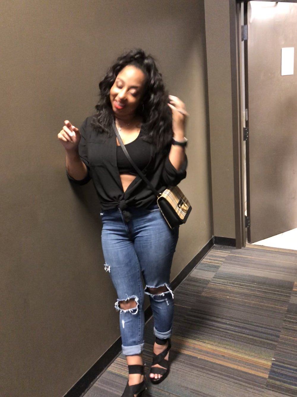 """I so LOVE Levis jeans … especially these!! I wear these a lot 😂 but that's ok! That's why you buy clothes right? Anyway, I have a few pair of Levis jeans and they all fit so good. These are high waisted (to hide the mom belly) and they have little to medium stretch to them. I paired them with a black button up from Express and a crop under it from  Fashion Nova . The crossbody is from Burberry. The classic  Burberry  design has red stripes in it so that's why I incorporated the red """"DAP Lip"""". """" Dabble """" to be exact! 💋  Whenever you're going out with your man, get cute and remind him of how versatile you can be. You're mom at home ( with the messy bun, sweatpants, and ketchup on your shirt from your kids using it as a napkin😒) but a model when you're out ….. Ok maybe not a model but you get the picture 😜.  Do love your Levis?  ❤️Feel free to comment and share❤️"""