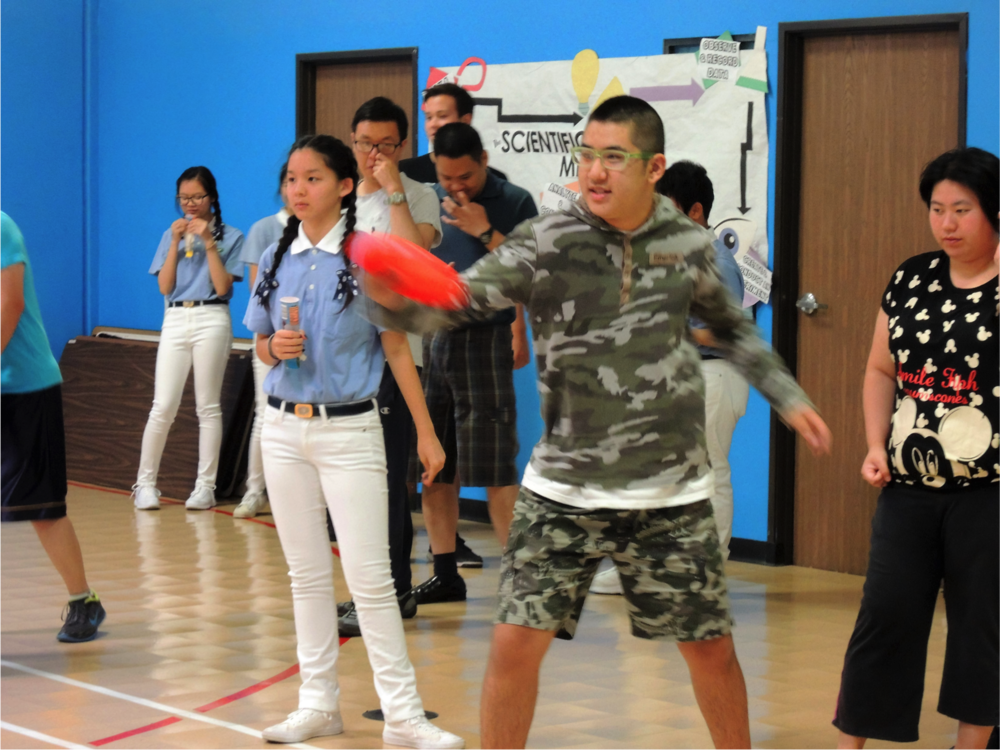 Mei Ye's son, Laker, throwing a frisbee at the Los Angeles Chinese Parent Association for the Disabled center.   Photo courtesy: Chinese Parent Association for the Disabled