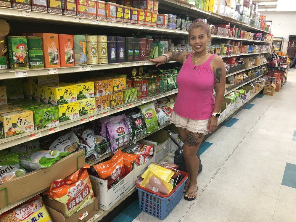 Ree Wisittasak shops at First Oriental Market. (Photo by Janaki Chadha)
