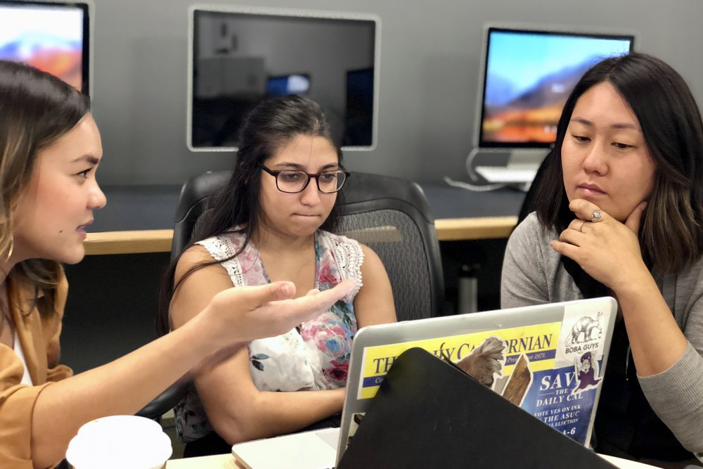 AAJA Voices mentors  Millie Tran , left, and  Alyssa Perry , right, work with student   Suhauna Hussain   in the media lab on the campus of the University of Houston at the Jack J. Valenti School of Communication.