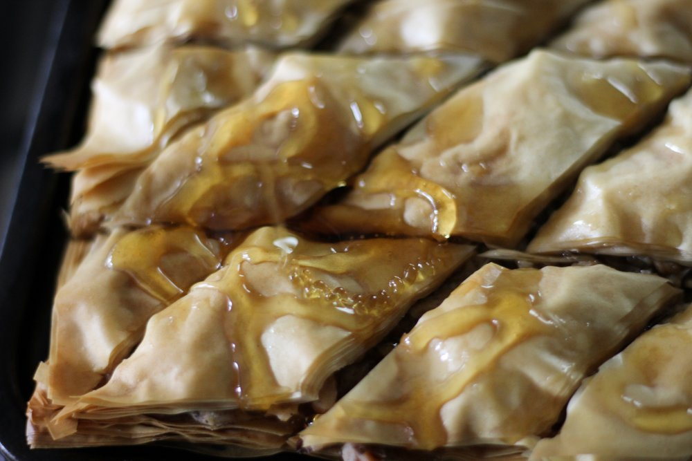 Pouring Honey on Baklava