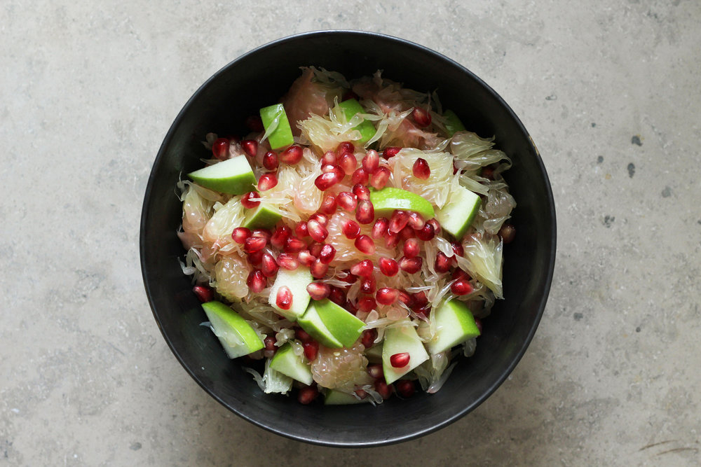 flower-water fruit salad with apple, pomegranate, and pomelo (can substitute grapefruit)
