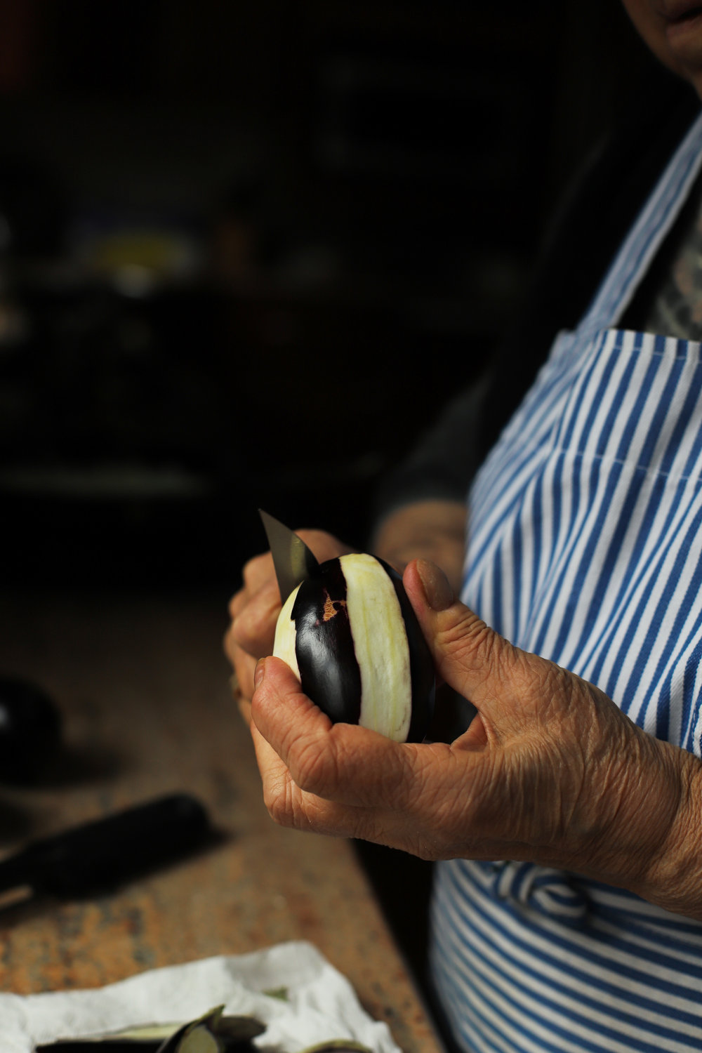 My grandmother stuffing eggplant for sheikh mahshi