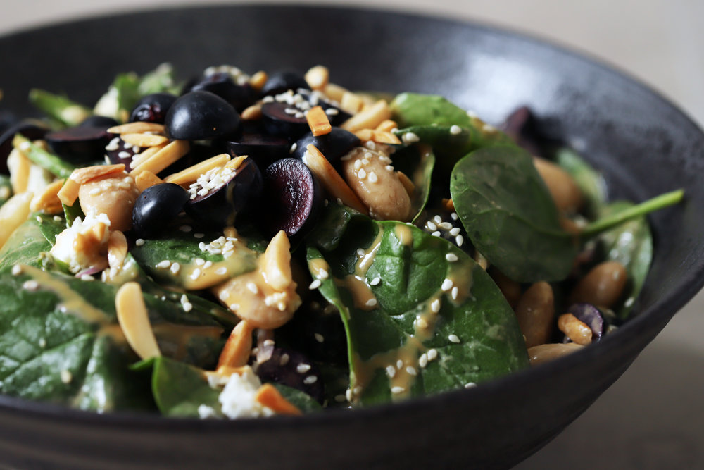 spinach salad with tahini date dressing