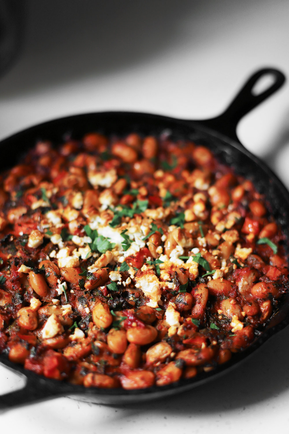 baked butter beans with nestled feta