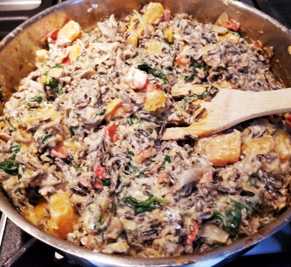Stir in Wild rice, vegan cream cheese, soy milk and arrow root until thick yet oh so creamy.