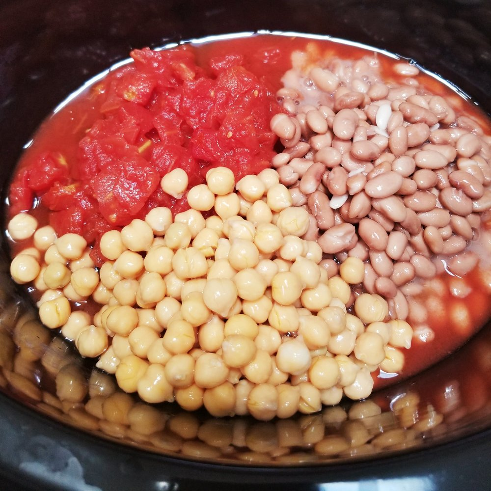 Please your diced tomatoes, Gobonza Beans, and Pinto Beans in the Crock pot.