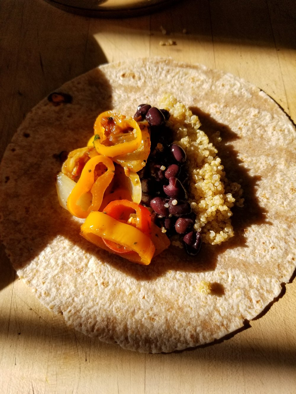 Line up Quinoa, Black Beans, and veggies on your tortilla