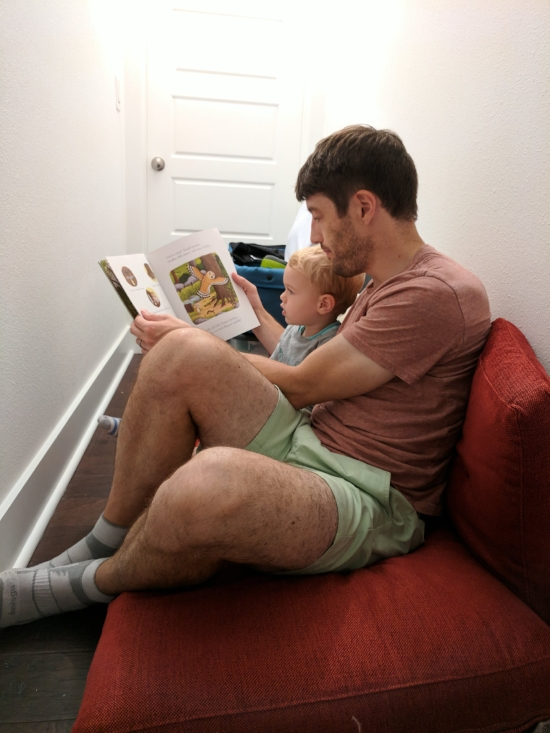 My husband reads to our toddler in the closet during Hurricane Irma. Image credit: Alexis Grant
