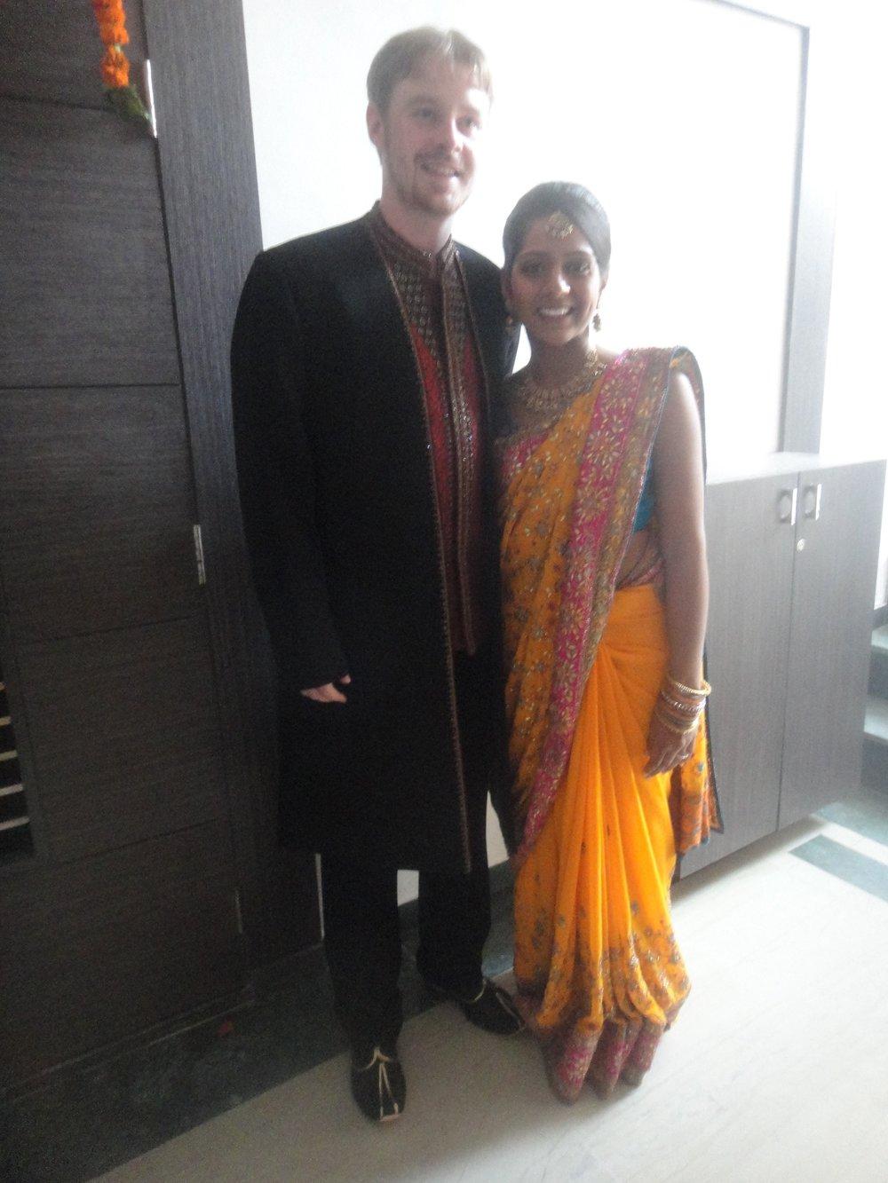 Examples of men's sherwani and women's saree