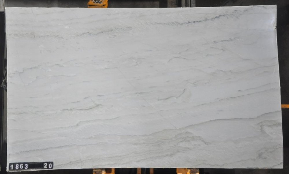 Quartzite  This stone is very dense and can have strong veining or subtle. The patterns can vary widely depending on the material. If you looking for a dramatic addition, consider Quartzite for your next project.
