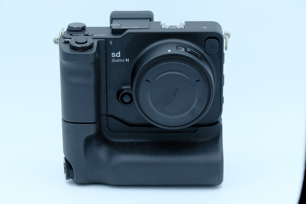 Sigma Sd Quattro H with Pg-41 power grip by Sigma.