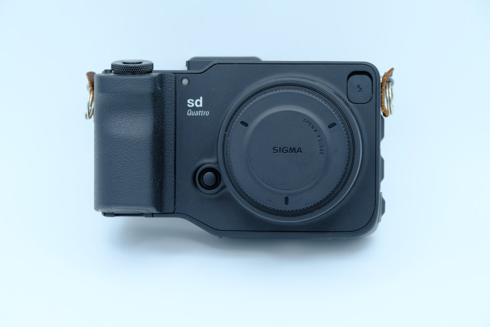 Sigma Sd Quattro without grip and front view, Body has same specs as the H model