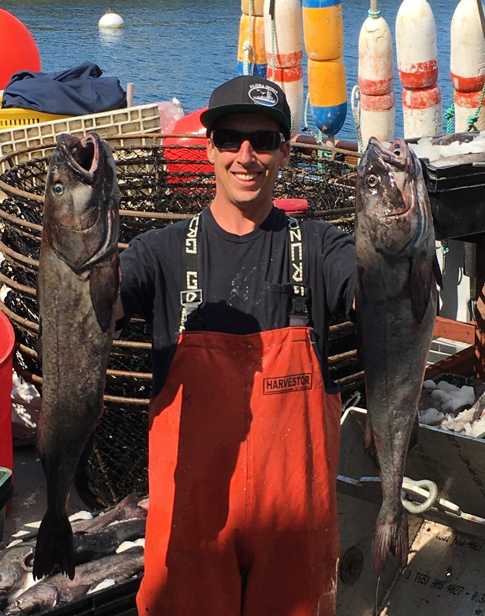 Jerry Wetle, holding a prized catch of 10-15 lb sablefish (black cod)