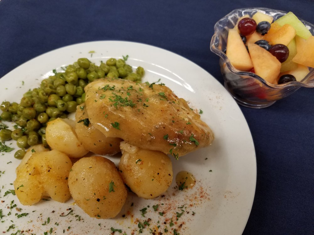 Apricot Glazed Chicken with Roasted New Potatoes and Green Peas with a side of fresh fruit.