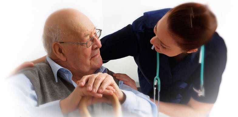 Healthcare worker comforting an older gentleman