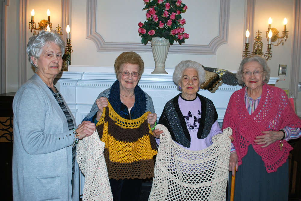 First Baptist Church of Mount. Holly Women's Ministry representative donating hand knit and crocheted shawls to the residents of Riverview Estates.