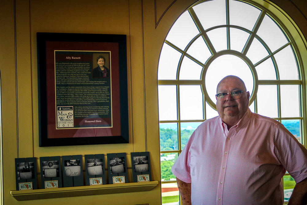 Bob in his office with the plaque dedicated to his granddaughter Ally