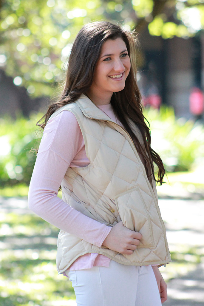Pastel pink sweater with a puffer vest